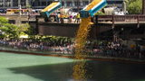 More than 63,000 rubber ducks were dumped into a Chicago River for a 14th annual Ducky Derby on Thursday.
