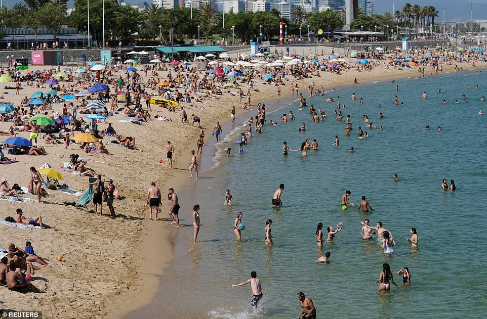 The prejudiced dismantling of Priti Patel's quarantine intrigue means UK holidaymakers will be means to lapse home though carrying to self-isolate for 14 days (pictured, people suffer a comfortable continue during a beach in Barcelona)
